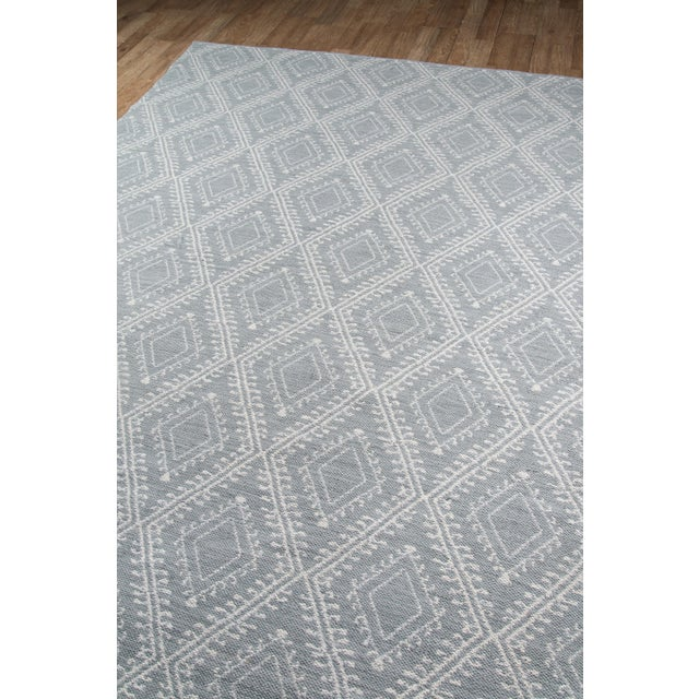 Tone-on-tone textures abound in this decorative rug collection with tribal influences. Hand woven from soft synthetic...