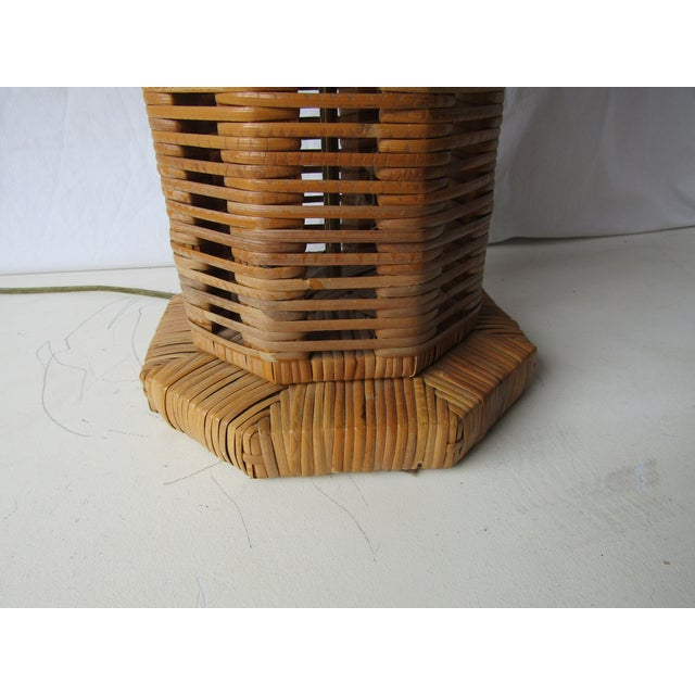 Unique basket / woven Rattan tall table lamp. The lamp has eight sides and is tall at 25 inches without harp and shade....