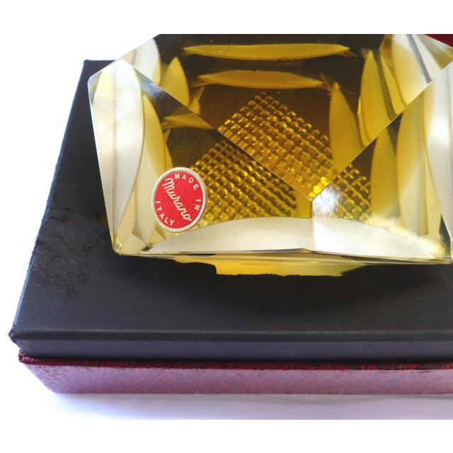 Offered for sale is a Murano glass brilliant cut diamond shape paperweight with the original box. Purchased in Bologna,...