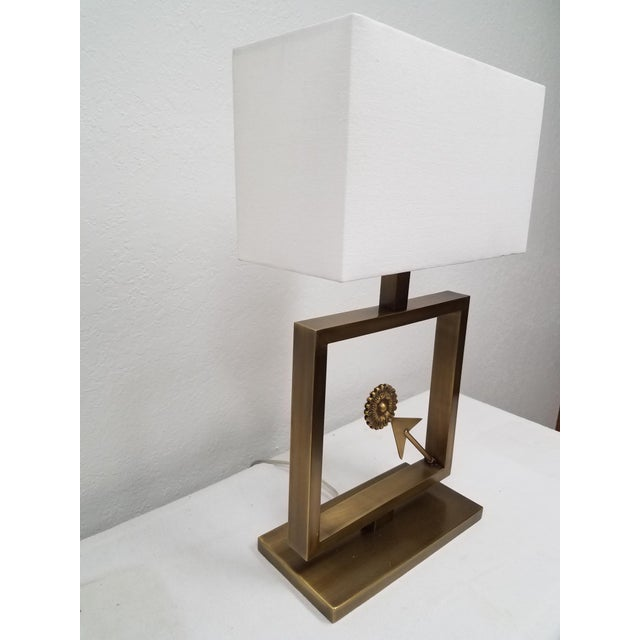 Modern Table Lamp with Arrow - White Linen Shade Stylish metal lamp with an arrow pointing to a medallion. Quite versatile...
