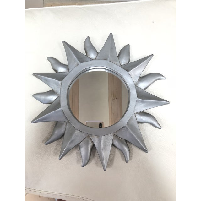 Silver petite sunburst mirror with hook from the 1980s. The piece was made in Taiwan.