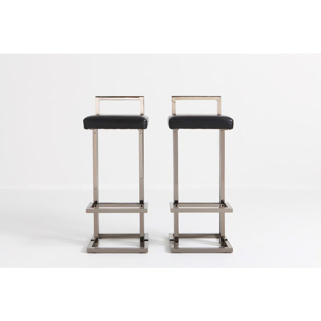 Chrome pair of bar stools by Maison Jansen, made in France, 1980s. Chrome frame and black leather seats, in very good...