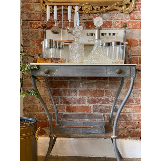 Antique Dry Sink Table with a Zinc frame and Marble top, back and small shelf. Also known as a chamber pot table, this...