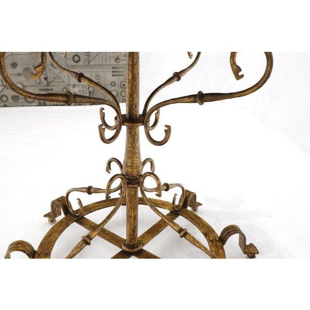 Hollywood Regency era large gold gilt wrought iron planter.