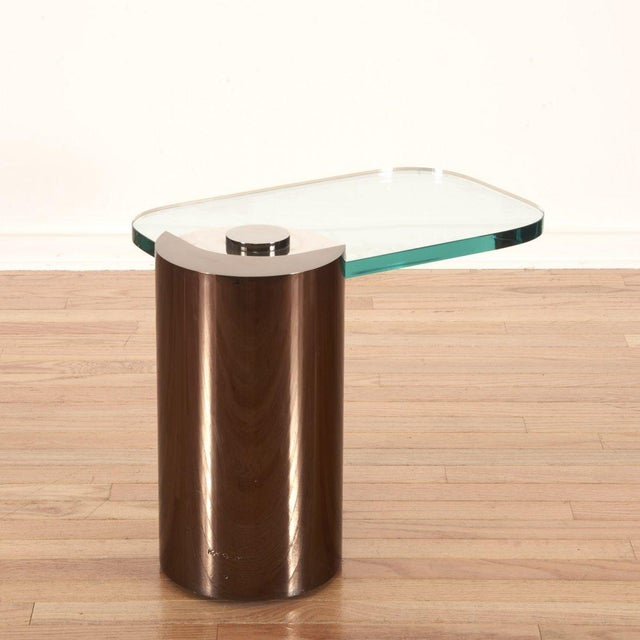 Signed, Karl Springer Cantilevered Side Table. Mixed metal frame with glass top.