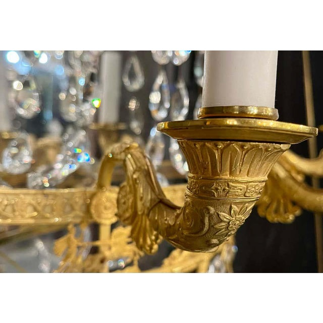 Pair of Maison Baguès mirrored wall lights, sconces. This stunning pair of large and very impressive wall sconces in a...