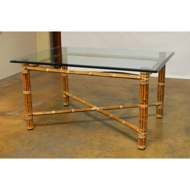 Organic McGuire bamboo dining table with bamboo legs and stretchers accented with leather rawhide strapping. Attractive...