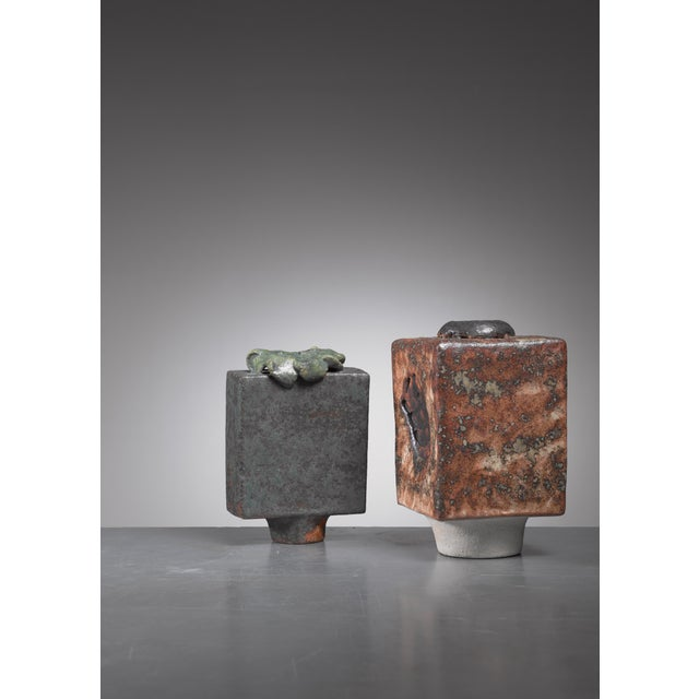 A pair of sculptural ceramic vases by German ceramist Lotte Reimers (1932). The measurements stated are of the anthracite...