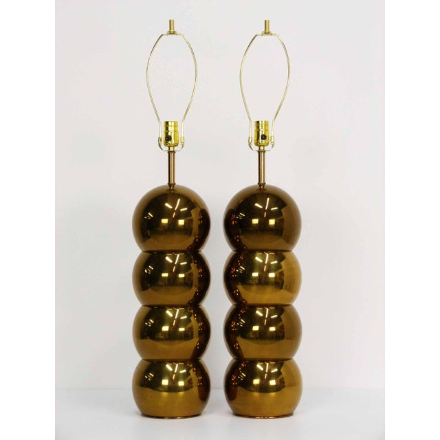 A pair of stacked brass ball table lamps by George Kovacs. No maker's mark. New wiring in working condition, 60W standard...
