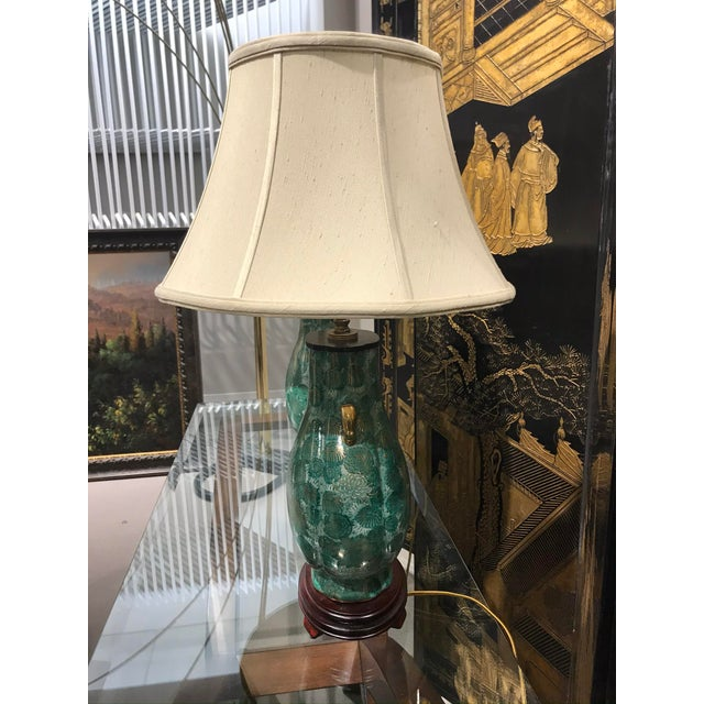 Beatiful green chinoiserie painted table lamps featuring gold handle made from old Asian vases / ginger jars. They have an...