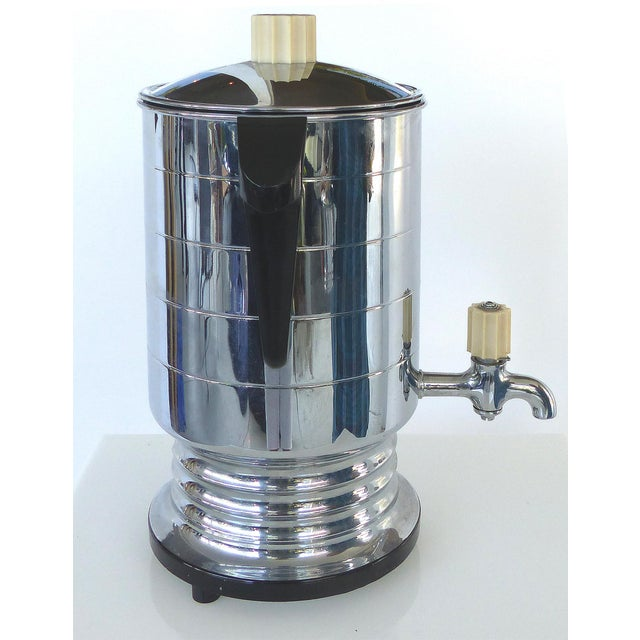 Offered for sale is a 1960's General Electric Chrome Coffeemaker / Perculator with Cream Sugar & the original cord. The...