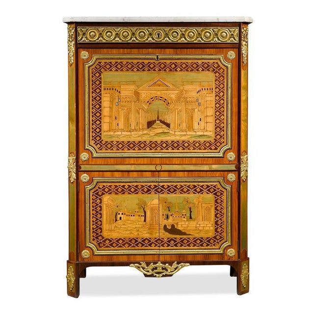 This remarkable secretaire à abattant by master ébéniste André Gilbert features colorful marquetry in rosewood, amaranth,...
