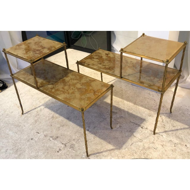 Maison Bagues superb gold bronze two tier side tables with eglomise mirror top