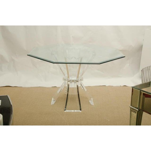 Double butterfly Octagonal Lucite dining table with Beveled glass top. The Lucite base in the shape of 4 butterfly-like...