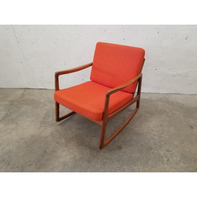 This Ole Wanscher for France and Son teak rocking chair looks amazing from just about any angle, and is in excellent...