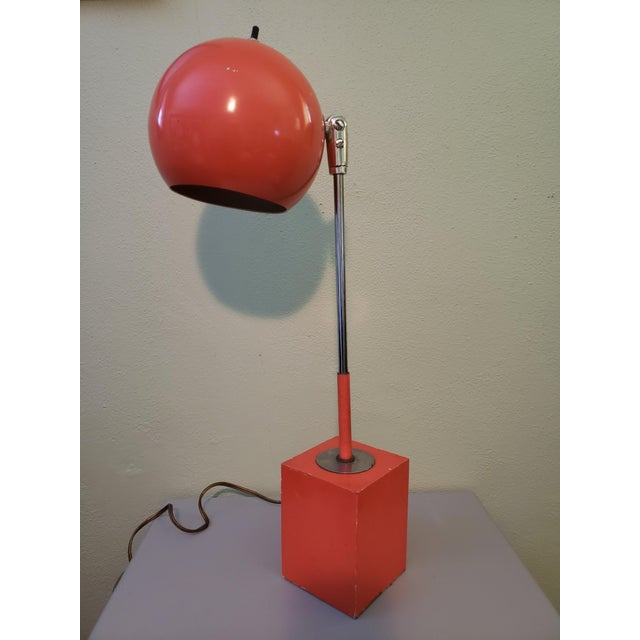 Vibrant Orange Eyeball lamp. It is a vibrant Orange with the silver arm. It does show wear but is in perfect working...