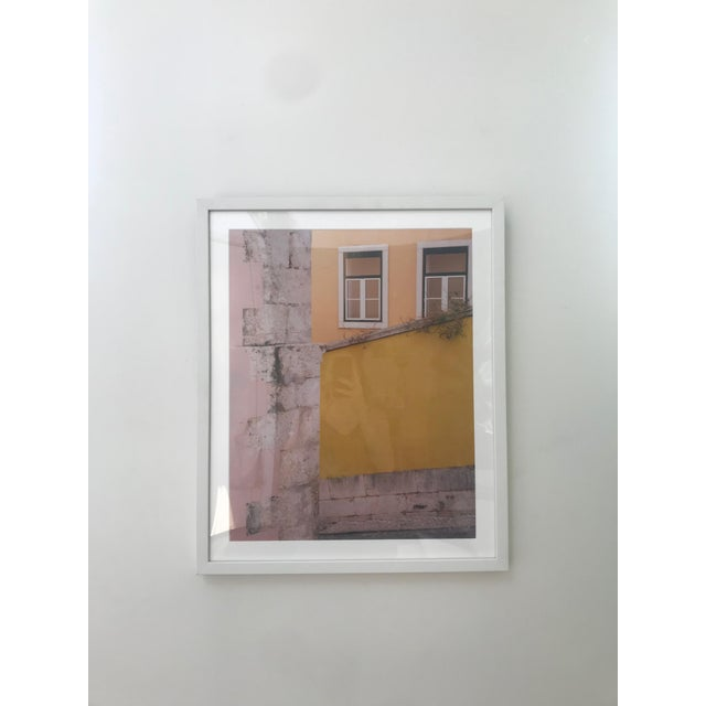 This is a beautiful photograph of Portugal by Halation Studio. The piece is framed in a simple white frame.