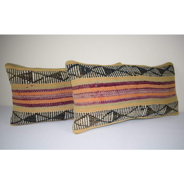 This handwoven kilim pillow is made from Anatolia and Middleast Kilim fragments. Each of our kilim pillow cover is cut...
