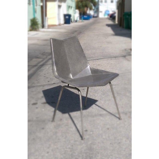 Single vintage Paul McCobb Origami chair produced by the St John seating corp, New York. Made of grey reinforced...