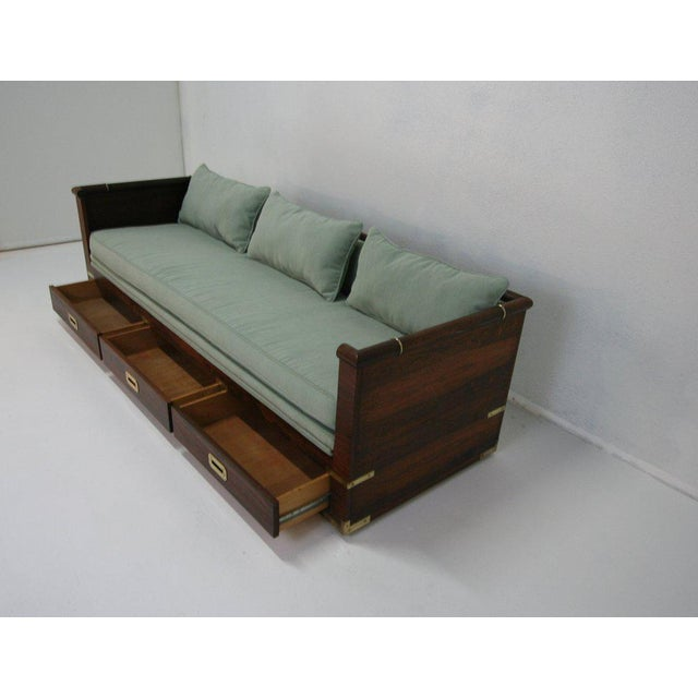 Original Marge Carson campaign rosewood sofa that can also be used as daybed. This piece is on casters for easy moving....