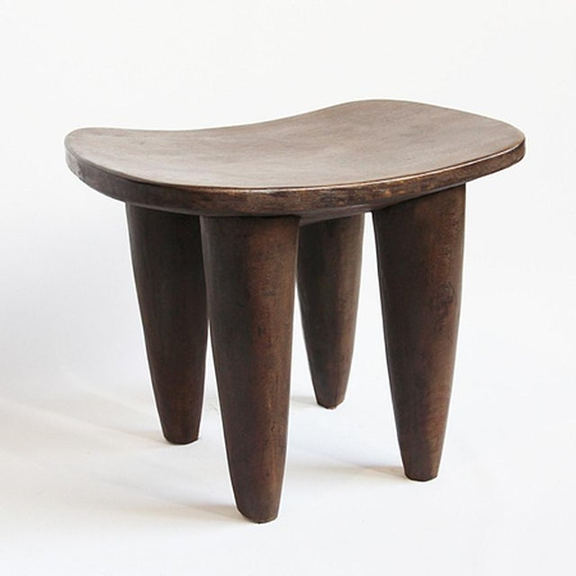 Original hand carved Senufo tribal stool from Burkino Faso. Carved from one solid piece on indigenous wood with beautiful...