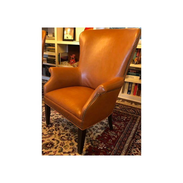 Williams-Sonoma Michelle Camel Leather Wingback chair. Beautiful chairs offering classic comfort and timeless character....