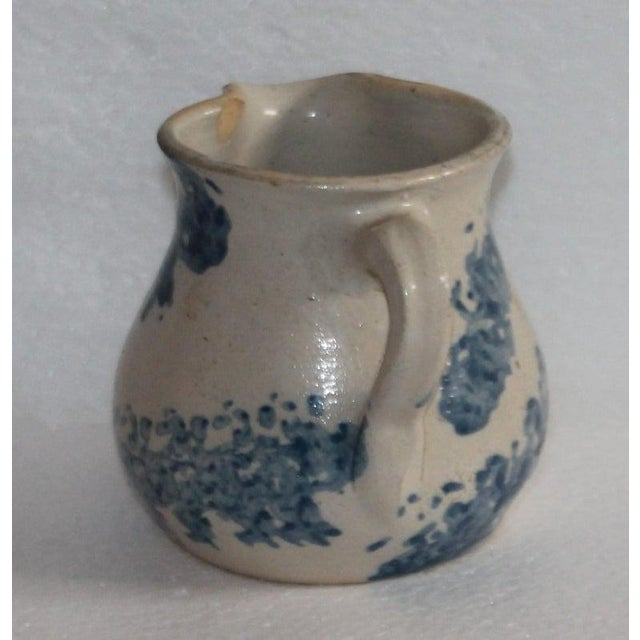 19th century rare form sponge ware milk pitcher in pottery. This is a handmade piece. The condition is very good with a...