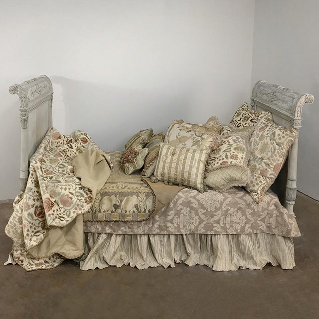 19th Century Painted Directoire Day Bed features the unique architecture and embellishment of the style, with a two-toned...