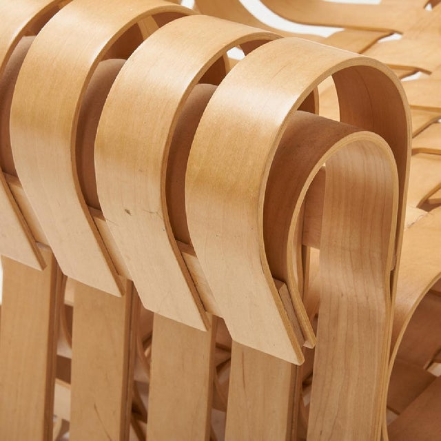 FRANK GEHRY KnollStudio® Power Play™ Chair and Ottoman Item #94L USA, 2001 Bent and laminated maple Inspired by the...