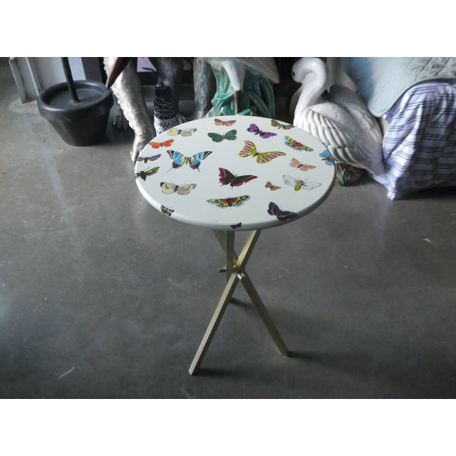 Iconic Fornasetti butterfly side table. Sold as found without damage.