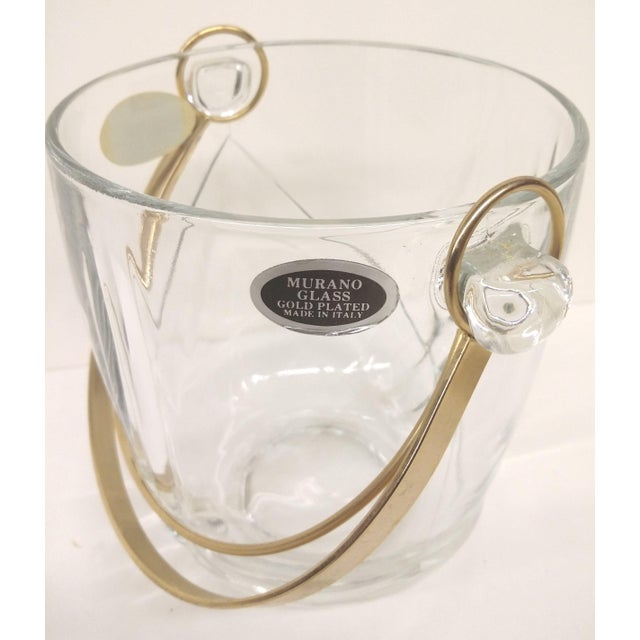 Well, the title tells the story. Still has tags on it, never used gold plate Made in Italy ice bucket. Marked Murano...