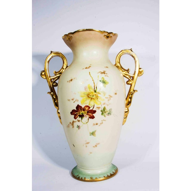 Antique French porcelain decorative vase / piece with gold handle. The vase measure 16 inches high x 11 inches diameter.