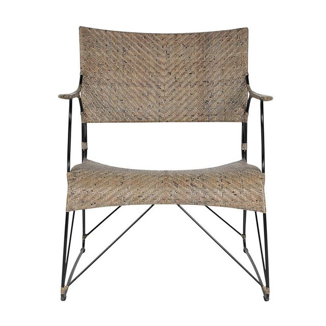 This David Francis lounge chair features a powder-coated steel frame wrapped with woven cane in a Herringbone pattern. The...