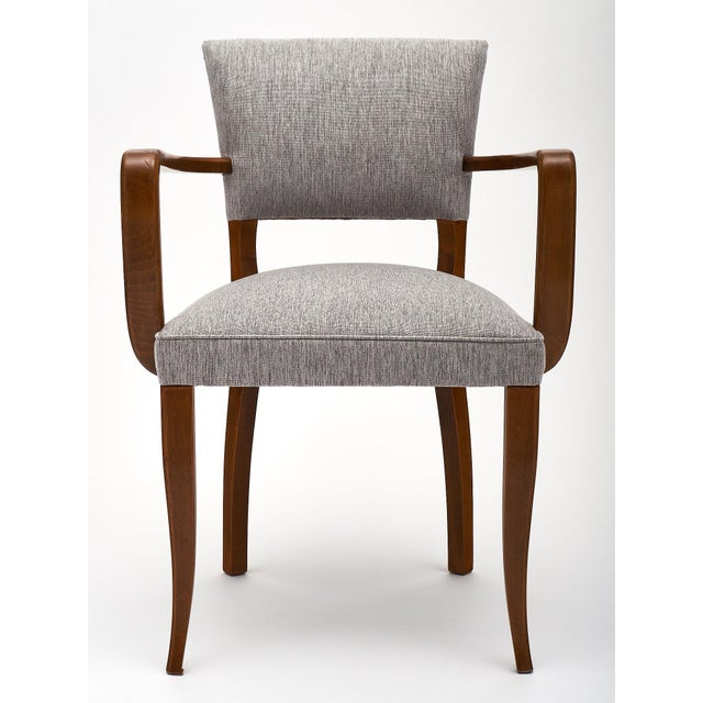 A set of eight French Art Deco bridge chairs made of of walnut and newly upholstered in a gray linen blend. We love the...