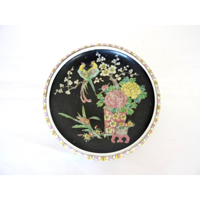 Old hand decorated Japanese bowl on three tripod legs. Attractive colourful border of yellow, pink and green encloses a...
