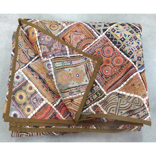 This is an amazing hand-made quilt that utilizes vintage and antique fabric cuttings from Indian Wedding Sarees. The hand-...