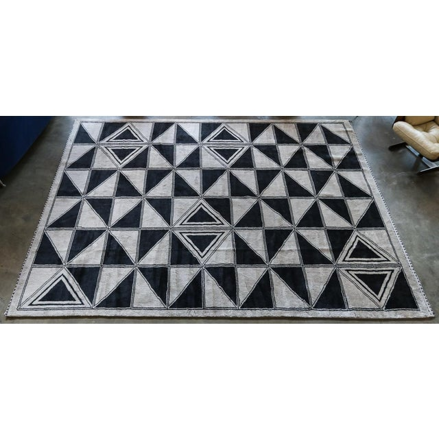 Custom Moroccan wool rug with geometric triangle pattern. Shown 9'×12'. Can be done in different sizes.