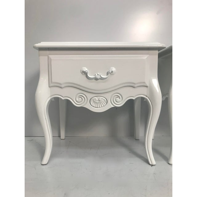 Pair of 1960's vintage Ethan Allen French style nightstands with beautiful detailing, handles and dovetail drawers....