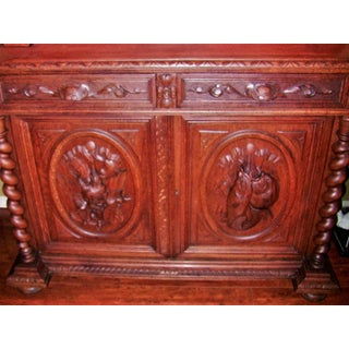 Early 19th Century French Provincial Highly Carved Oak Bookcase Preview
