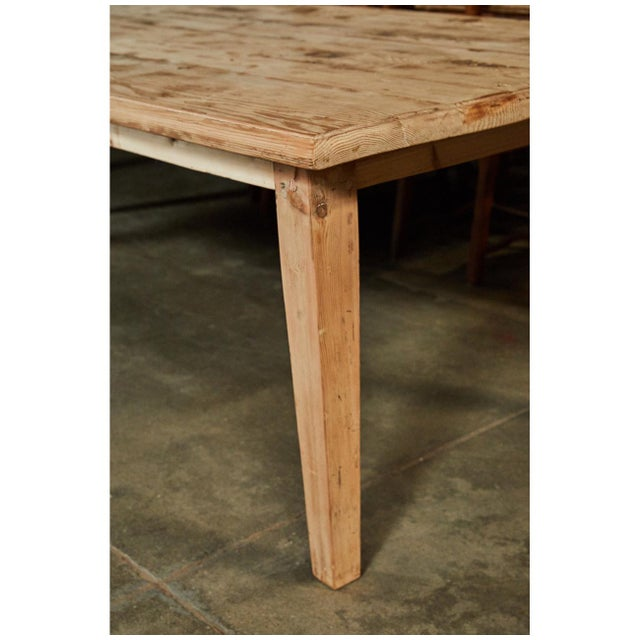 This large Pine table is a great size for a dining or work table. It has nicely tapered legs and a simple skirt. This...