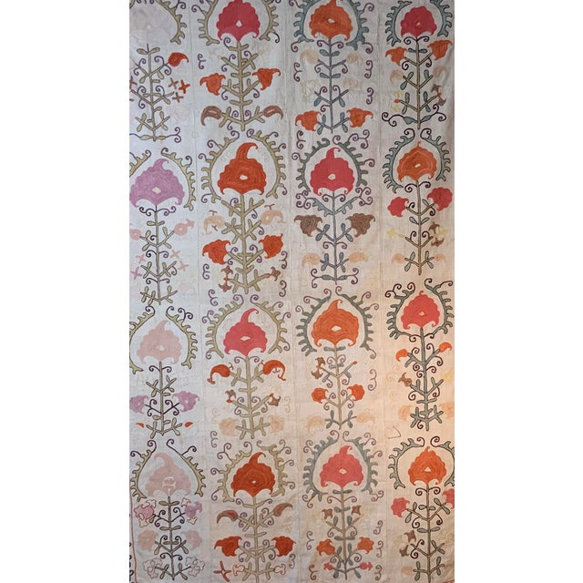 Antique Suzani textile made of hand embroidery intricate scrolling vines and flowers motifs on a handwoven cotton...