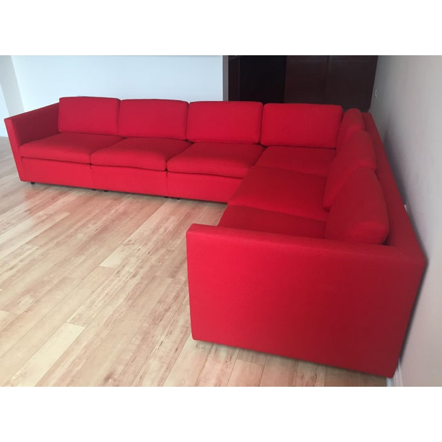 This striking red L-shaped corner sectional was purchased from Design Within Reach sometime in the 2000's. It was...
