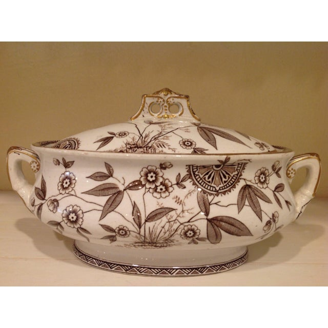 Exquisite 19thC Aesthetic Movement oval tureen with lid and stand. Brown floral and landscape/seascape pattern on white...