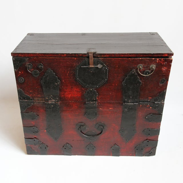 Use this Korean trunk table as a nightstand, side table, or hallway storage. Its rich, red-tone wood is artfully off-set...