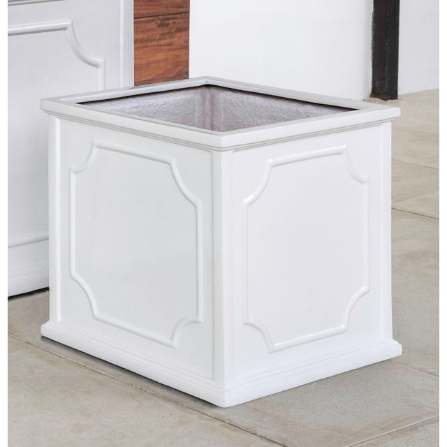 A square planter of Fiber Clay Composite in a glossy white finish. Available in multiple sizes or as a set of three.