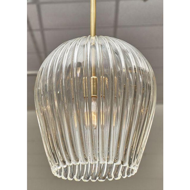 Murano glass and brass bell shaped pendant chandelier with whimsical lantern glass in a bell shape and brass rod. This...