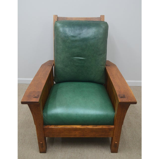 High quality. Solid Oak. Adjustable back rest. Comes with ottoman.