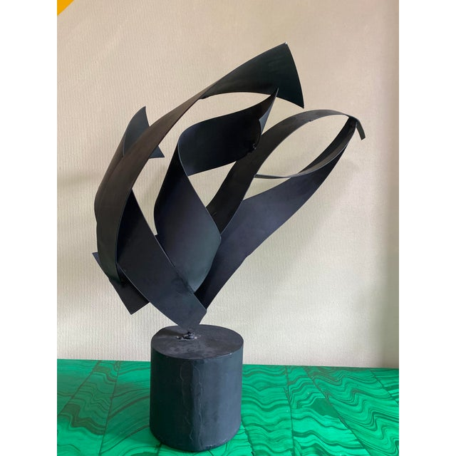 Beautiful artist made black abstract steel sculpture mounted to a concrete base. Unsigned. This item came the estate of a...
