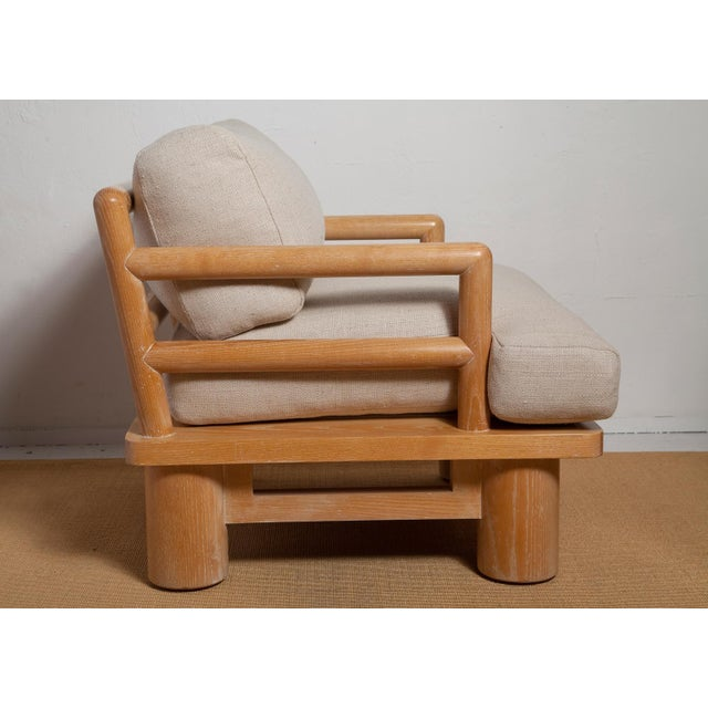 """One of Karl Springer's rarest and most desirable designs, this gorgeous pair of cerused oak """"dowelwood"""" lounge chairs..."""
