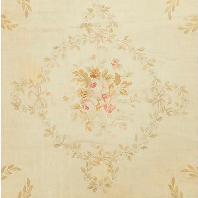 A wonderful square Aubusson in the typical soft creams and ivory colors so familiar in Aubussons of this period. Situated...
